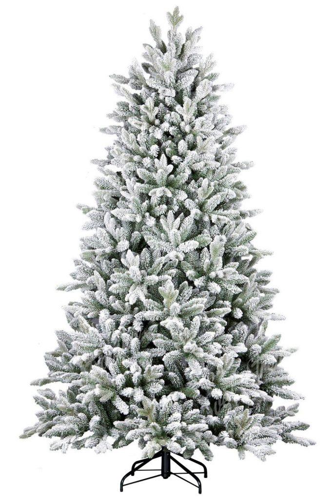 Na obrázku je krásný bílo nazelenalý stromeček uhlazeného jehlanoveho tvaru. Cely stromeček je zasněžený umělým sněhem a díky tomu je k nerozeznání od toho živého zasněženého stromku v lese. Stromek je postaven na kovovém stojanu.