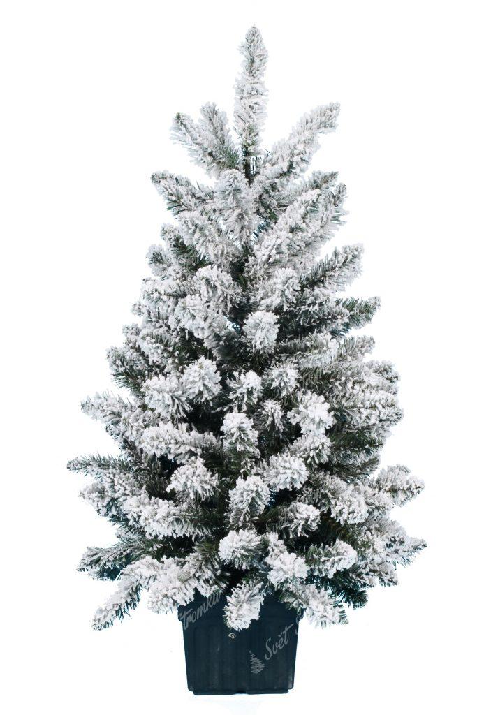 Maly bílý vánoční stromeček v umělém květináči.