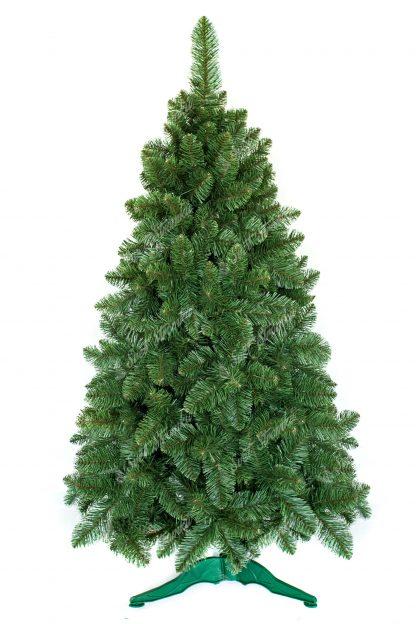 Umělý vánoční stromek bledší nazelenalé barvy. Stromek je postaven na umělém stojanu.