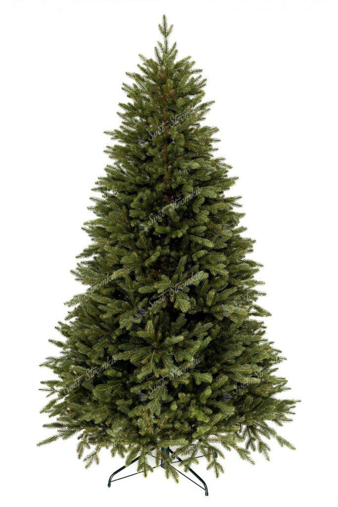 FULL 3D vánoční stromek tmavě zelené barvy. Stromek ma smrkové 3D jehličí a stojí na kovovém stojanu.