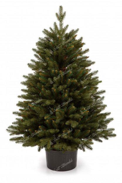 Malý vánoční stromek v květináči s tmavě zeleným 3D jehličím.